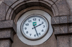 Clock. On a wall with kharkov town in ukraine symbol Royalty Free Stock Photos