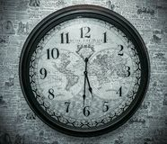 Clock on the wall. The old clock on the wall newspapers Royalty Free Stock Photography
