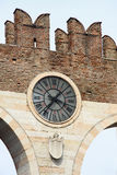 Clock on the wall of Portoni della Bra in Verona, Italy Royalty Free Stock Photo