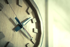 Clock on wall. Time passing  over the face of home office Wall Clock. Concept photo of time, timing, business, busy,deadline. - (Selective focus / Split tone Royalty Free Stock Photography
