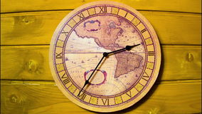 The clock on the wall. Timelapse. Analog Clock with the image of the world map hanging on the wall and work. Minute and hour hands run along the rim of the dial stock video footage
