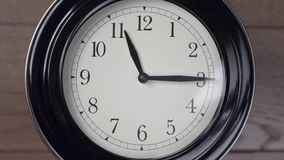 Clock on the wall. Timelapse. Close-up of clock moving fast stock video footage