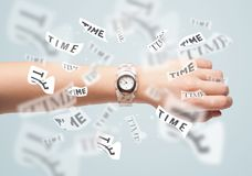 Clock and watch concept with time flying away. On paper Royalty Free Stock Image