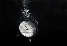 Clock in water Stock Images