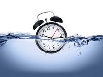 Clock in water. Mean time is limited Royalty Free Stock Image