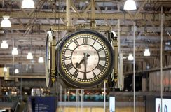 Clock of the Waterloo international train stationDeparture hall with lots of people Royalty Free Stock Photo