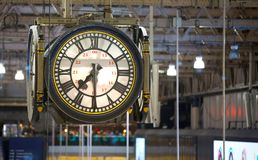 Clock of the Waterloo international train stationDeparture hall with lots of people Stock Photography
