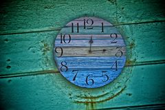 Clock. Weathered colorful round clock at beach in Crystal Cove California Stock Photos