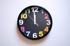 Clock on a white background. A few seconds to midnight stock photos