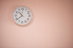 Clock white on a pink background. Stock Photography