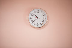 Clock white on a pink background. Royalty Free Stock Photo