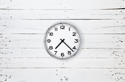 Clock on a white plank Stock Photos