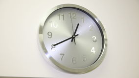 The clock on the white wall stock footage