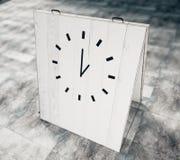 Clock on white wooden chalkboard on concrete floor. Mock up Stock Image