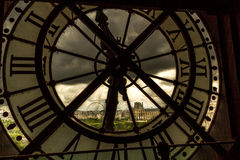 Clock Window in Paris. Looking outside at stormy Paris through a clock Stock Photos