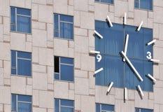 Clock and windows Stock Photos