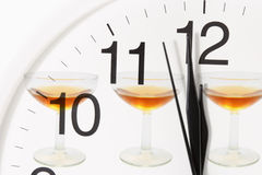 Clock and Wine Glasses Royalty Free Stock Photos