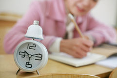 Clock With Girl In Class Room Royalty Free Stock Photos