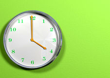 Clock With Green Hands & Orange Numbers Royalty Free Stock Image