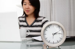 Clock and woman Royalty Free Stock Image