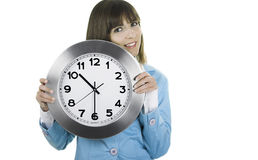 Clock Woman. Beautiful woman standing over a white background with a clock on the face Stock Photo
