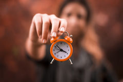 Clock and woman Stock Photography