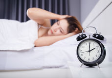 Clock with woman sleepless on bed. Clock with woman sleepless on the bed stock image