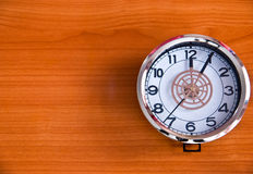 Clock on wood background Royalty Free Stock Images