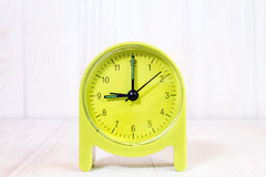 Clock on the wood background Royalty Free Stock Photography