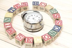 Clock with wood cubes on wooden table words hours,minutes,seconds cool. Clock with wood cubes on wooden table words hours,minutes,seconds Royalty Free Stock Photo
