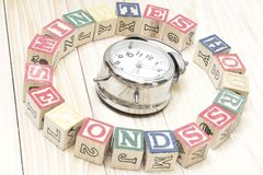 Clock with wood cubes on wooden table words hours,minutes,seconds cool. Clock with wood cubes on wooden table words hours,minutes,seconds Stock Photography
