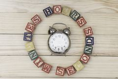 Clock with wood cubes on wooden table words hours,minutes,seconds cool. Clock with wood cubes on wooden table words hours,minutes,seconds Royalty Free Stock Images