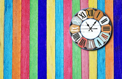 Clock on wooden wall Stock Images