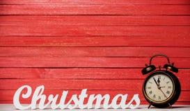Clock and word Christmas. Stock Photo