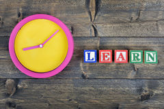 Clock and word Learn Stock Photo