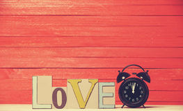 Clock and word Love. Stock Photography