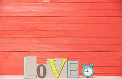 Clock and word Love. Stock Photos