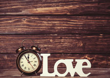 Clock with word love stock photography