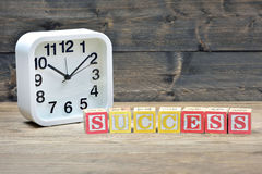 Clock and word success Royalty Free Stock Image