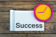 Clock and word Success Stock Image