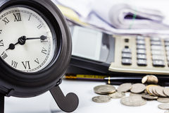 Clock and work. Clock on financial desk,concept of busy or working overtime Stock Photo