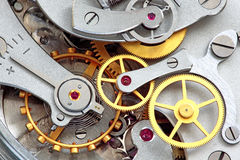 Clock works. Closeup of metal clock works Stock Photos