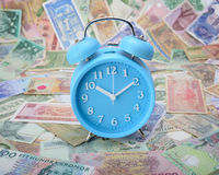 Clock on world currency. Notes Stock Photography