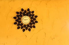 Clock on yellow wall Royalty Free Stock Photos