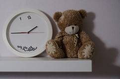 Clockand bear Stock Images