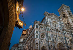 Clocked corner and Duomo. Upwards urban photo including a corner of a building with a clock, and the landmark duomo cathedral, Florence, Italy Royalty Free Stock Photography