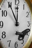 Clockface and key Stock Image