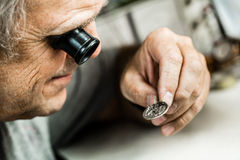 Clockmaker repairing wrist watch Royalty Free Stock Photography