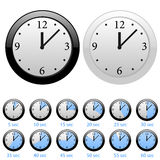 Clocks. Set of the  clocks in white and black styles Stock Photos