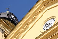 Clocks. On the reformed church in Debrecen, Hungary stock images